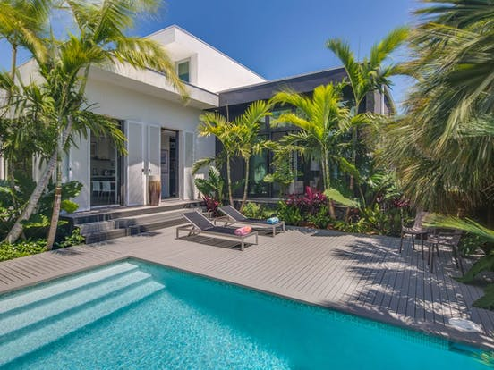 Key West vacation rental with outdoor pool and lounge chairs