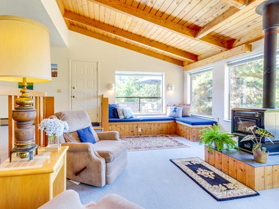 adorable wood accented living space with wood-burning fireplace in Sea Ranch, CA