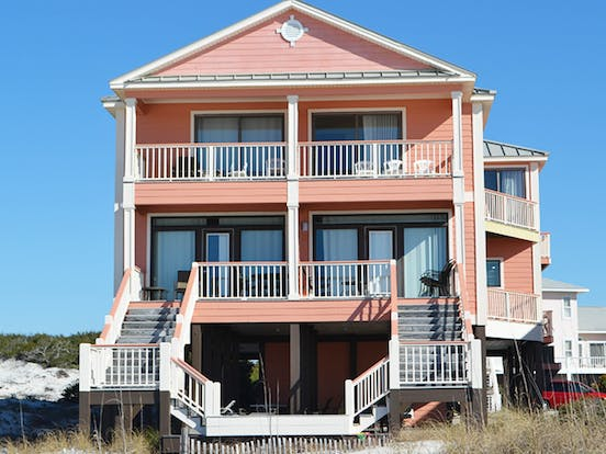 Salmon pink beach house located in Gulf Shores, AL