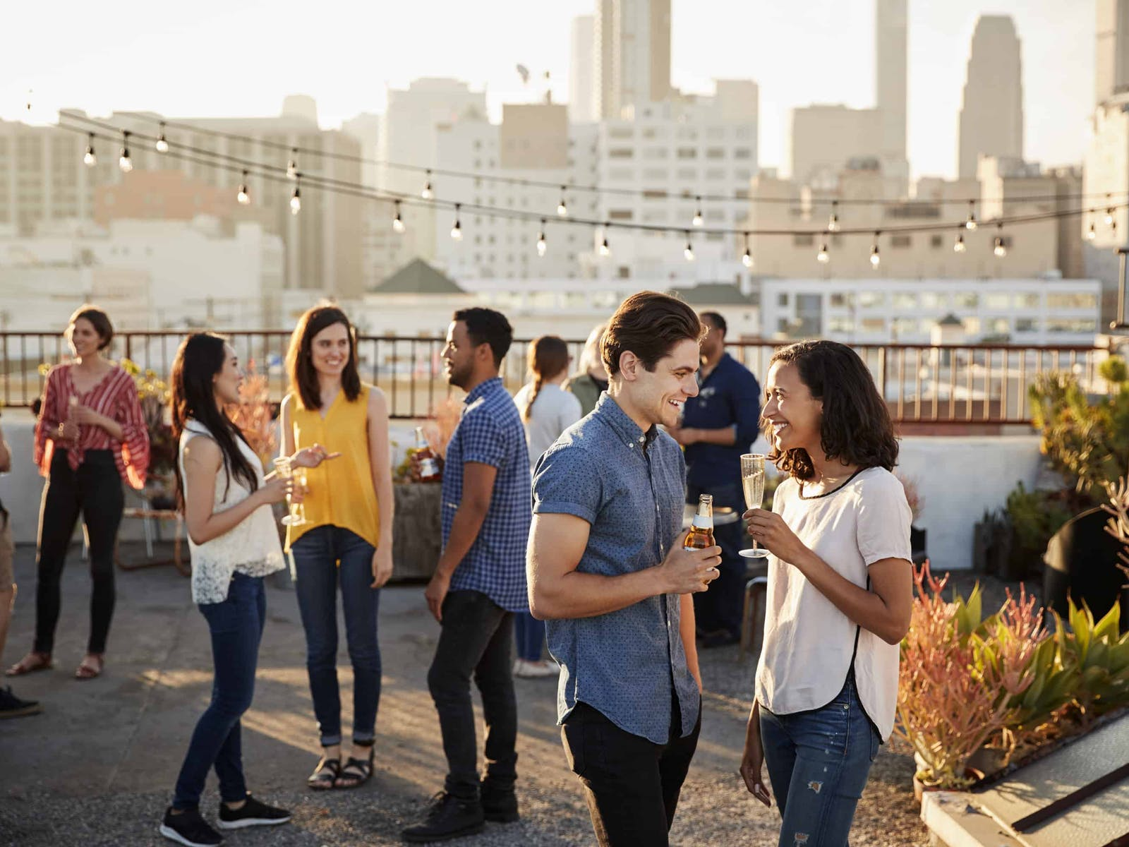 a group of people enjoying drinks on a rooftop