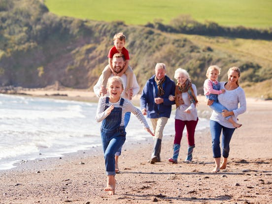 extended family enjoys a day at the beach