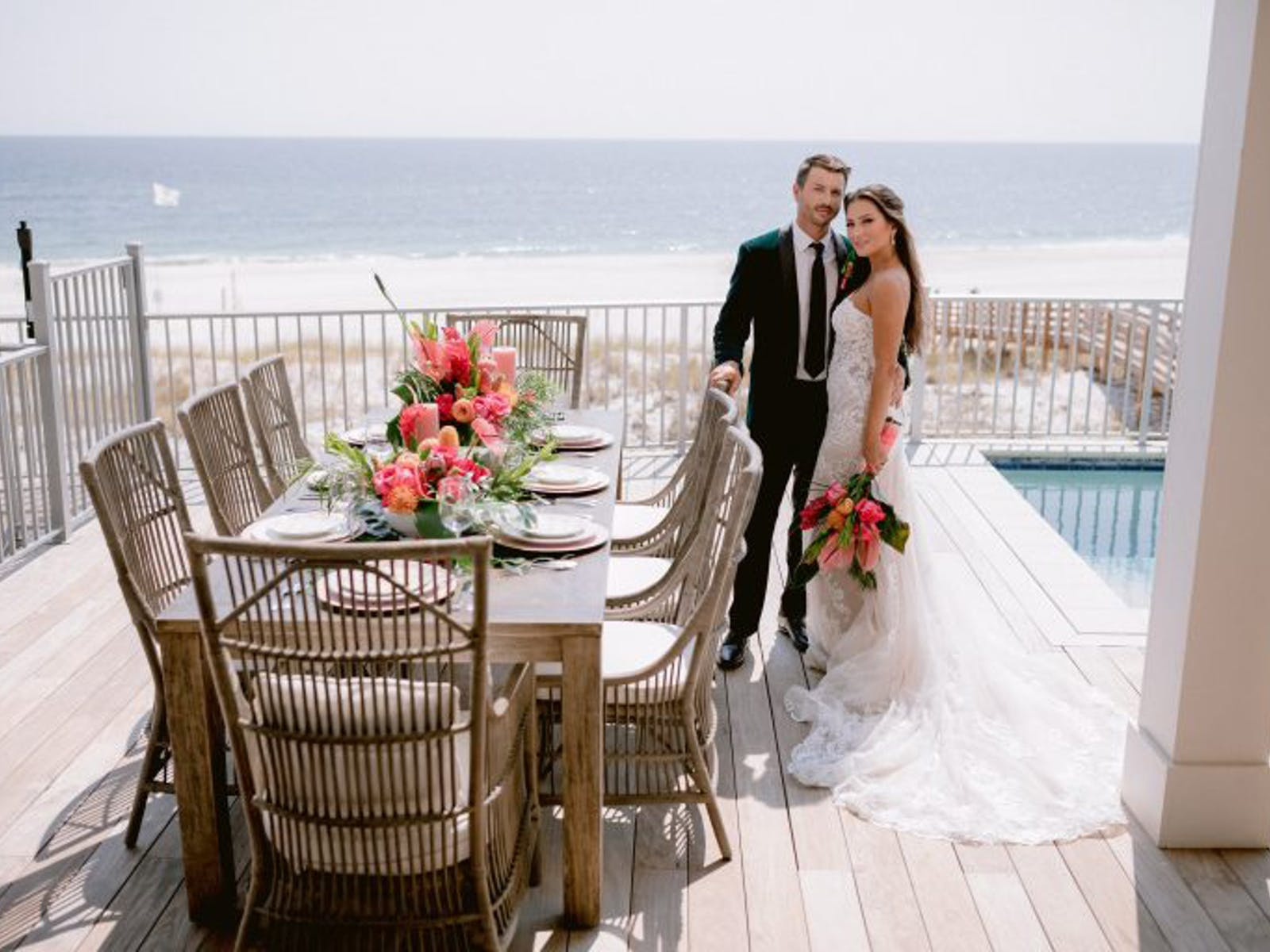 bride and groom pose for wedding pictures at their Alabama Gulf Coast wedding-friendly vacation rental