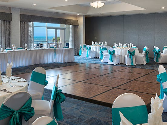 event venue inside Bay Watch Resort set up for a wedding reception
