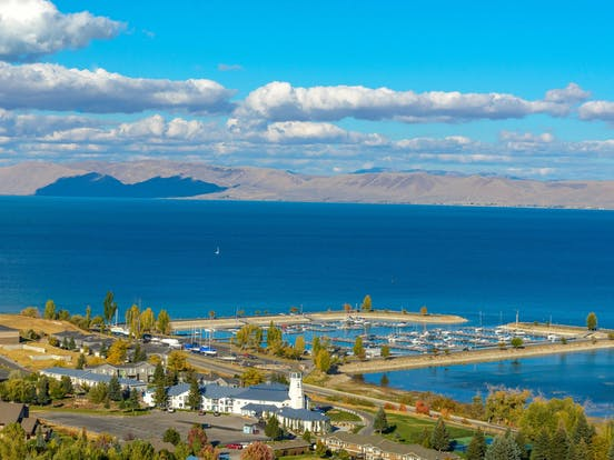 beautiful lake in Idaho surrounded by a small town and mountains
