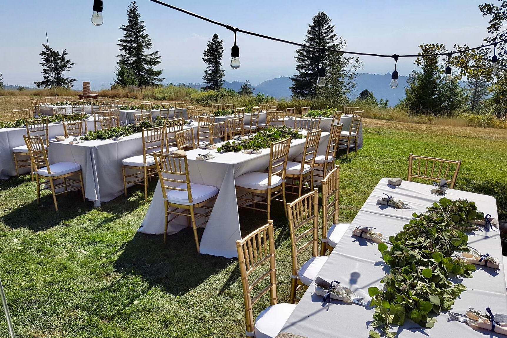 String lights and seating for Bogus Basin wedding dinner