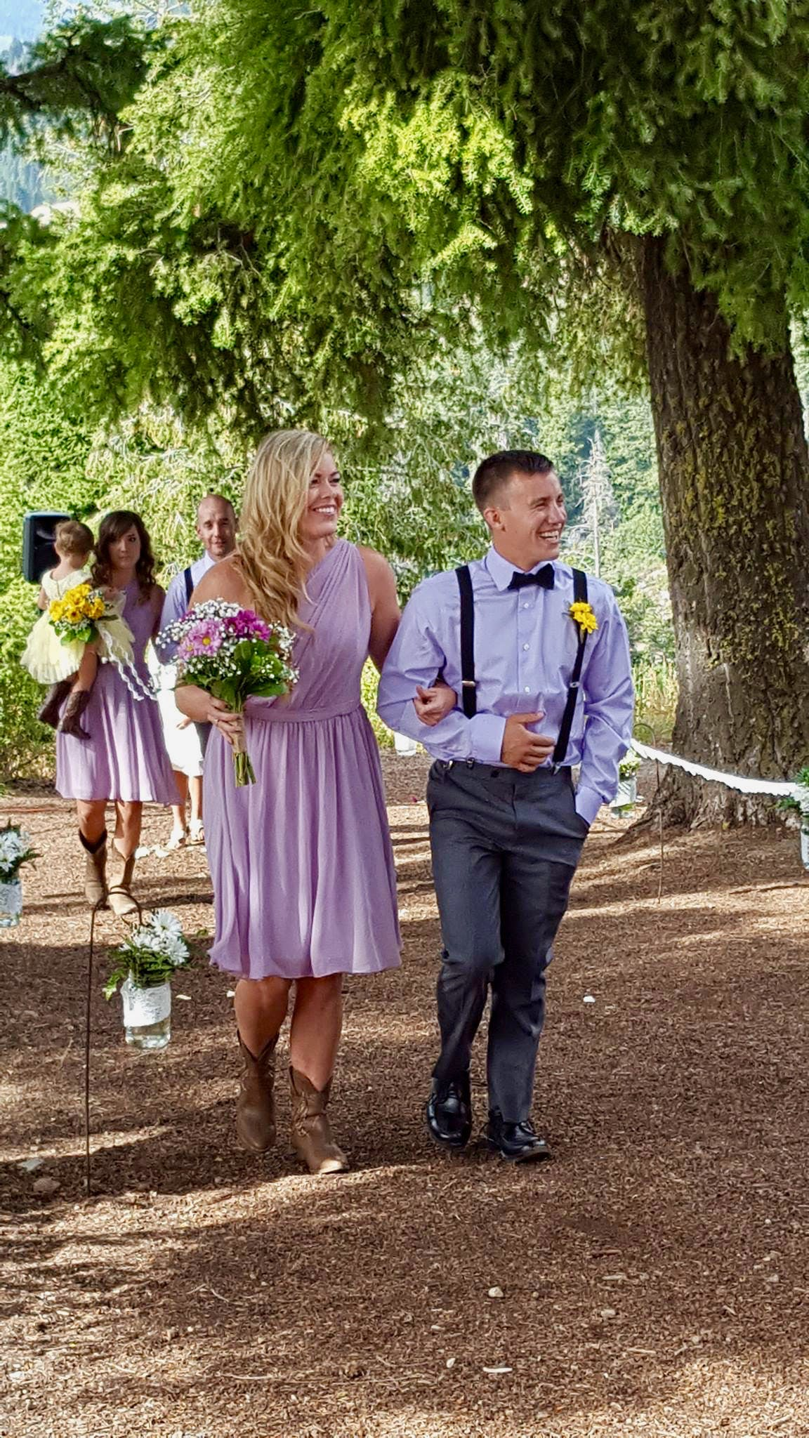Bridal party walking down the aisle for Bogus Basin wedding