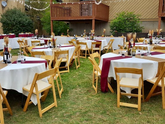 Round tables prepared for wedding night dinner