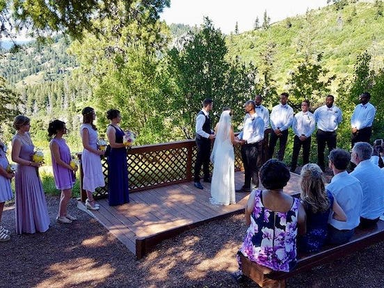 Wedding ceremony with bridal party at Bogus Basin