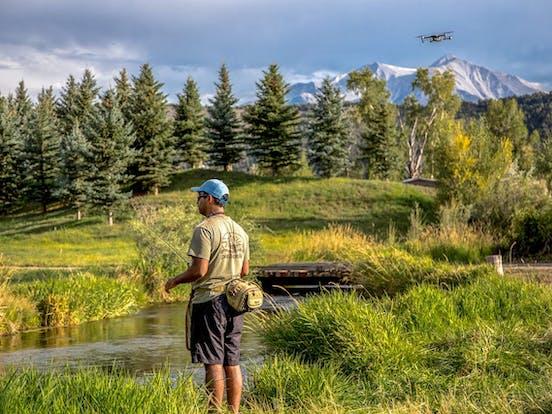 man fishing in Colorado river