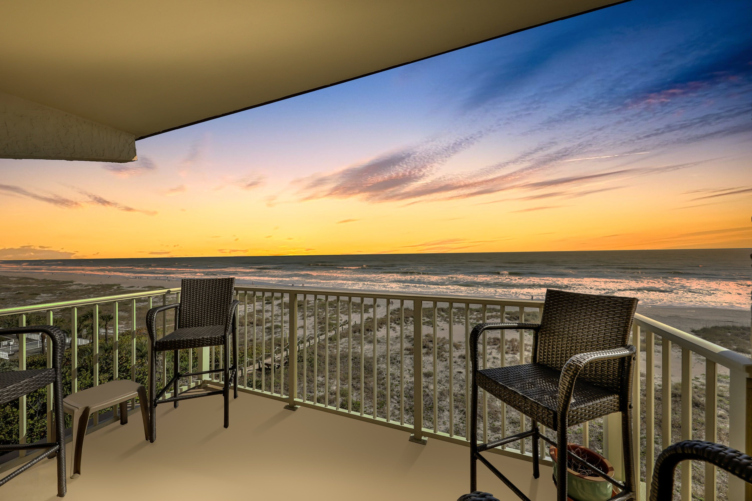 Balcony overlooking the ocean and beach during sunset in Cocoa Beach, FL