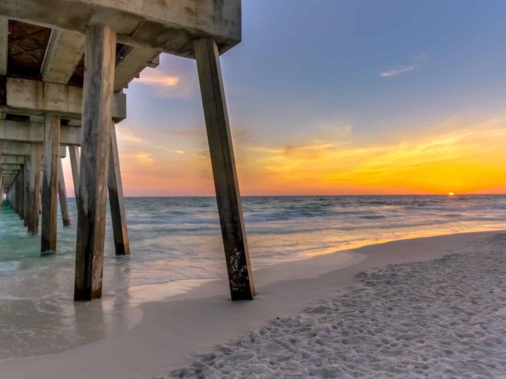 sunset view from the pier on the emerald coast in florida