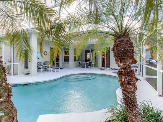 Davenport, FL vacation home with outdoor pool surrounded by palm trees
