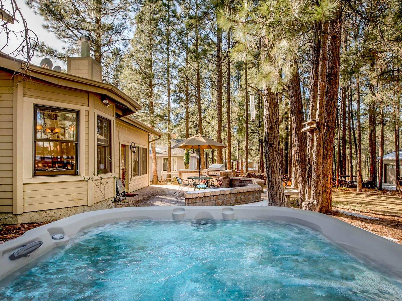 A hot tub outside of a cabin rental in Flagstaff, Arizona