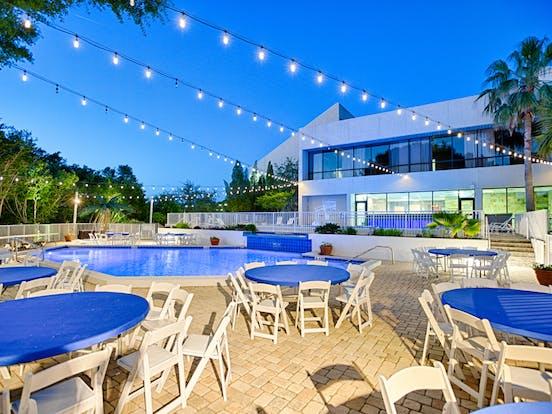 Club Tiki tables set up for a wedding reception
