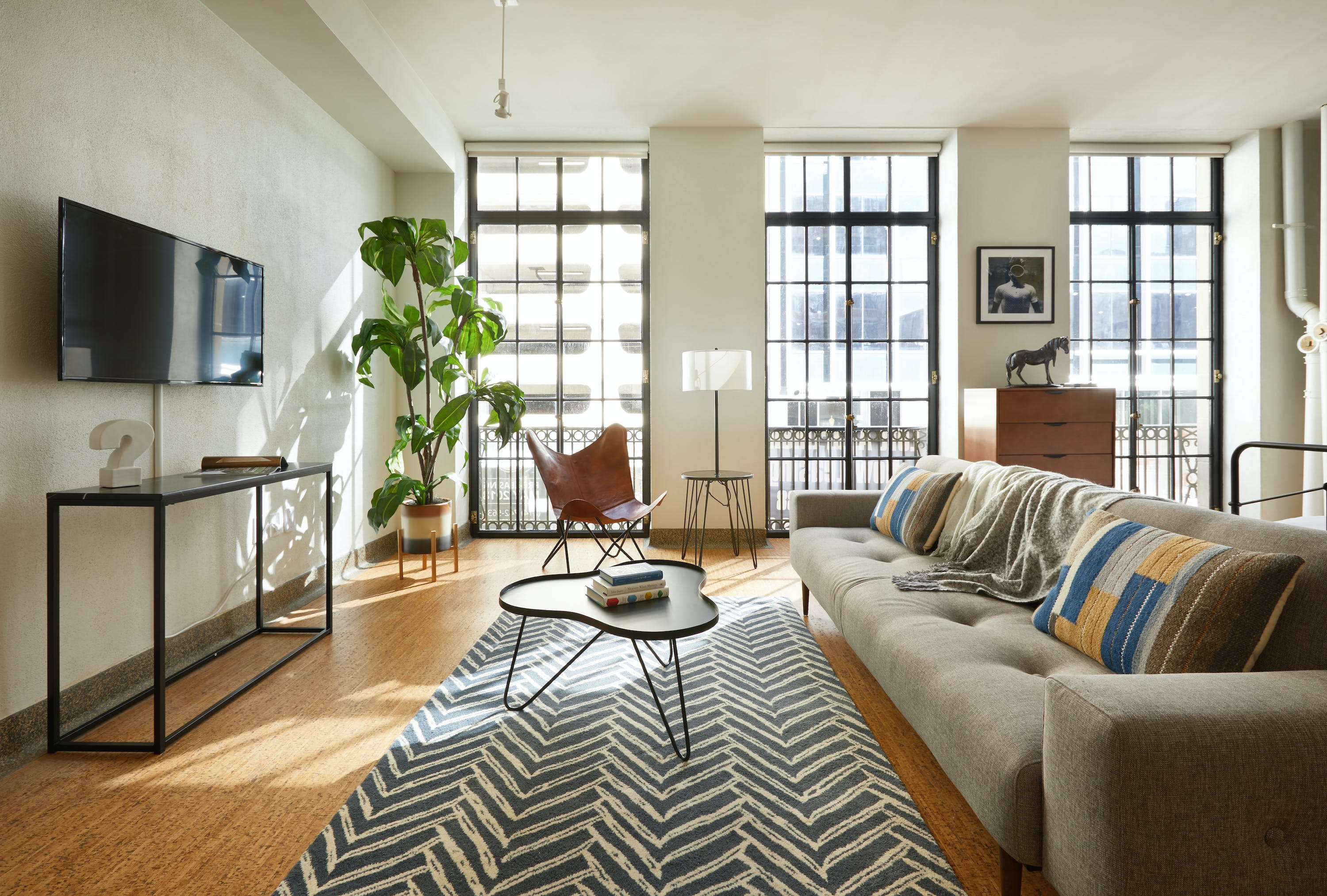 the living room of a downtown vacation condo with modern furniture