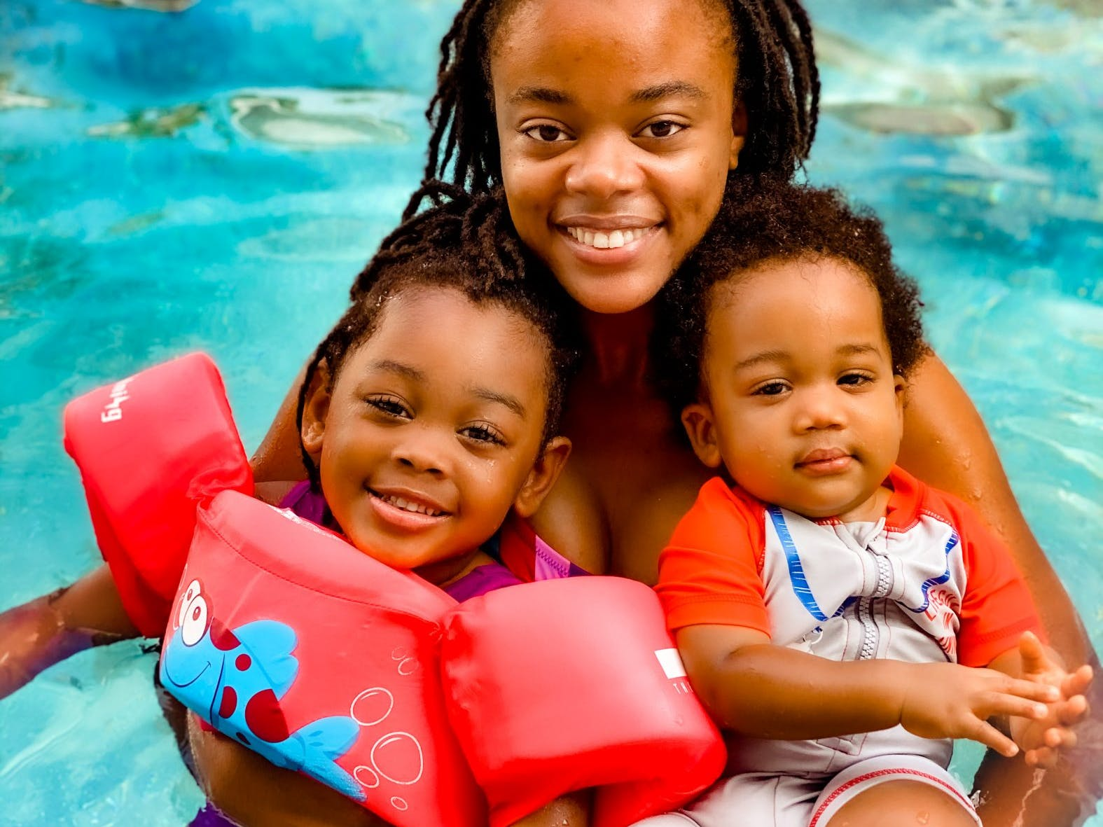 Victoria Graham and her two children swim in the private pool of their vacation rental