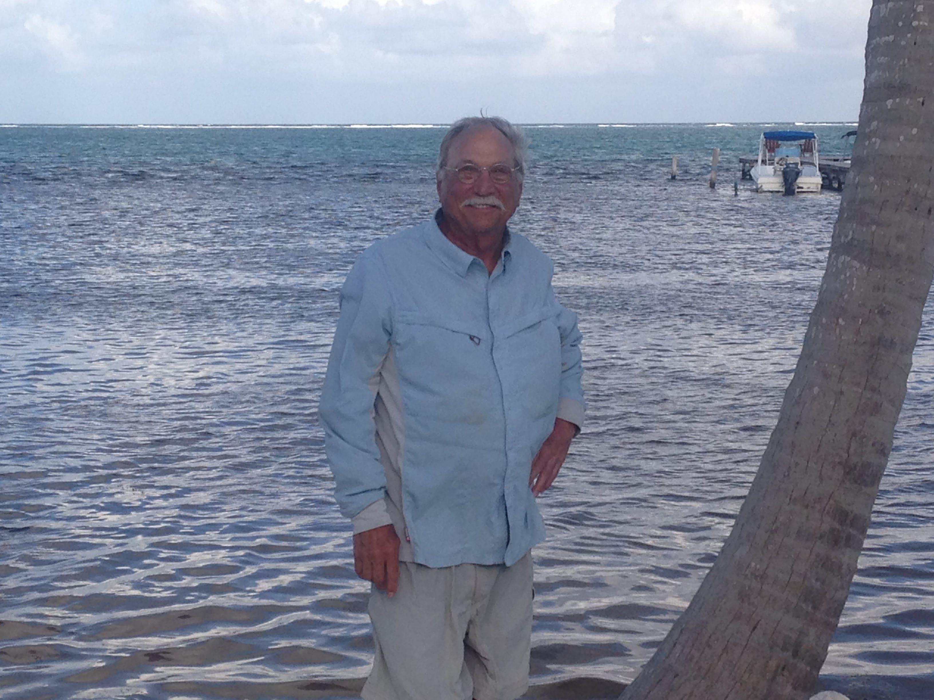 Gordan Paxman posing in front of body of water