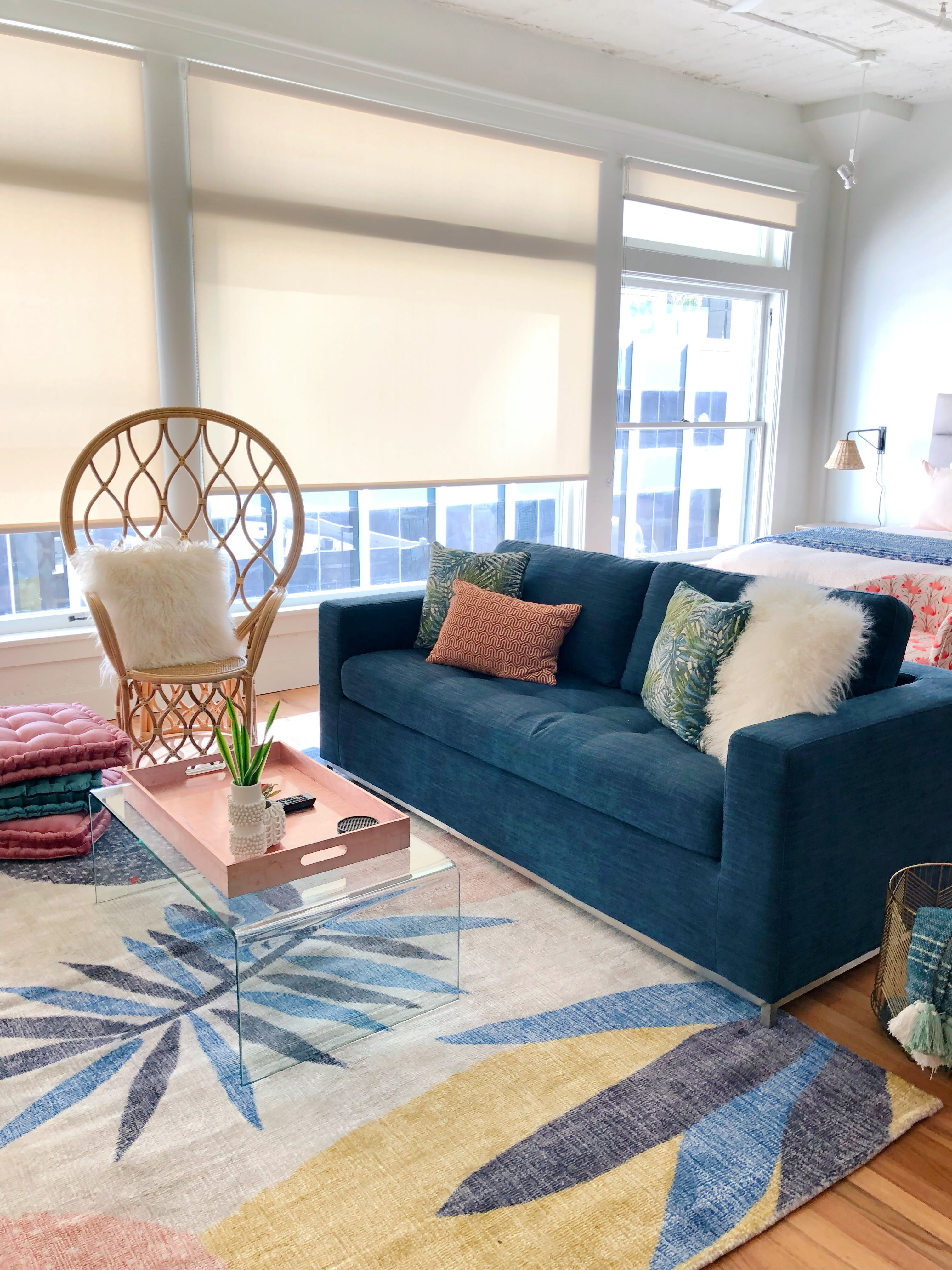 Blue couch artfully covered in throw pillows