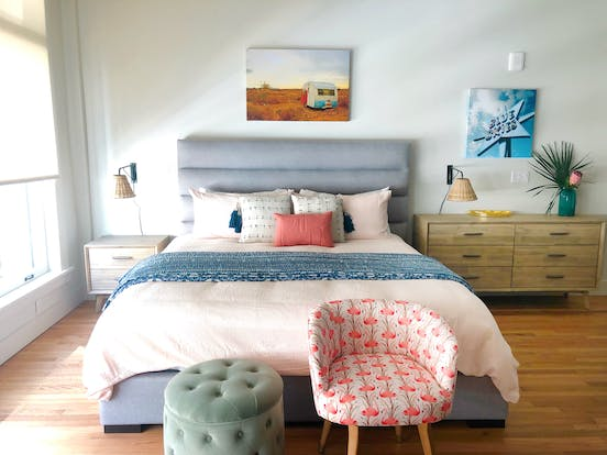 Cute vacation rental bedroom with boho decor