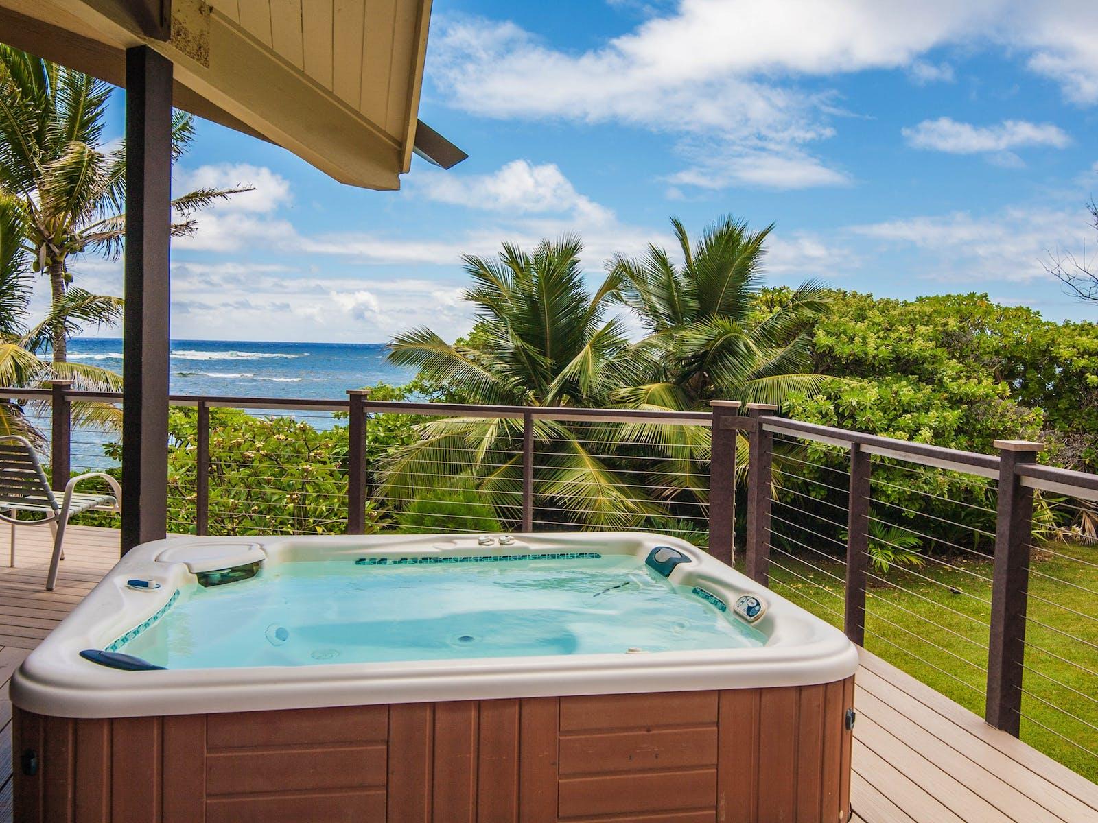 Private hot tub with beach and ocean views from Kauai, HI beach home
