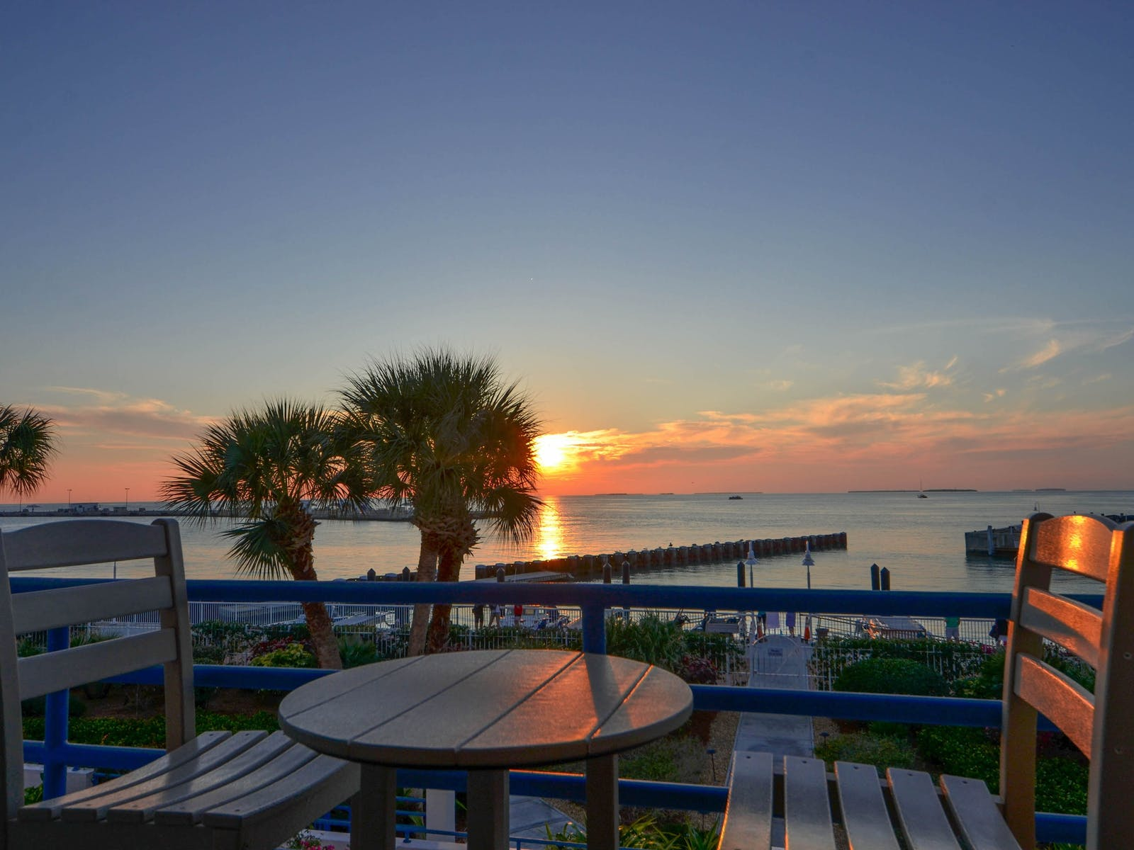 View of sunset over the water from Key West, FL vacation rental balcony