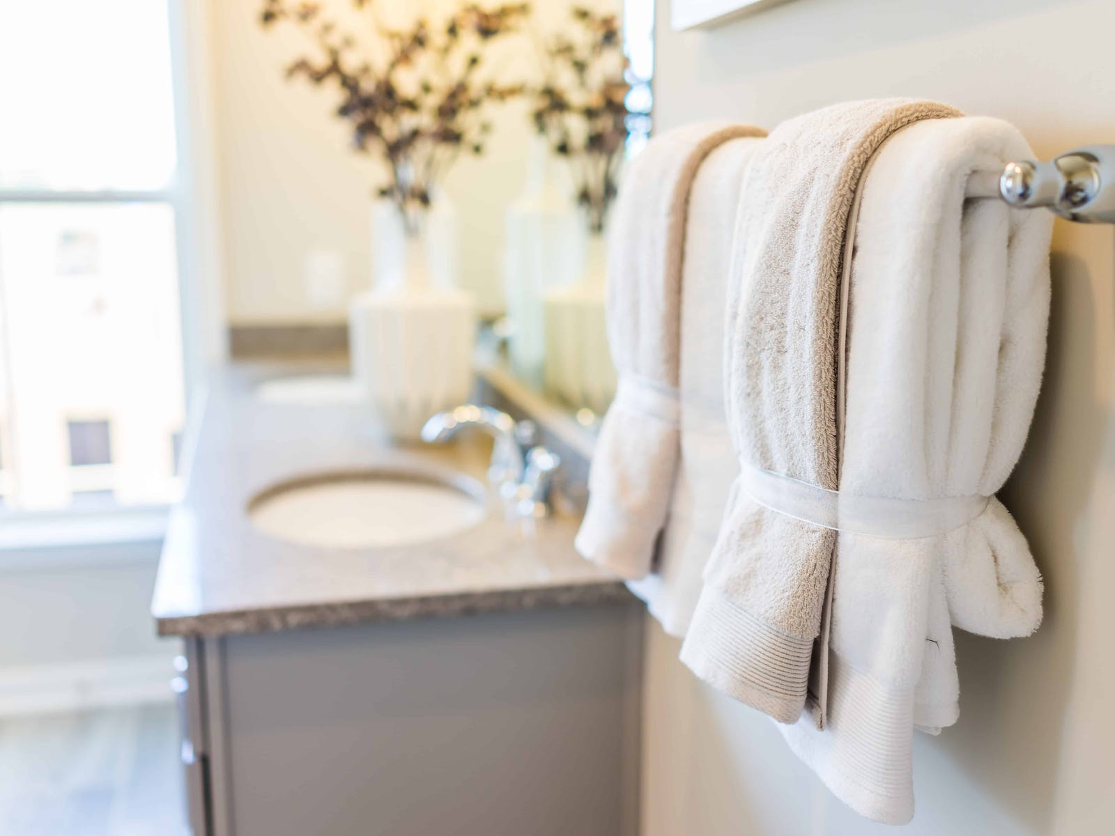 Professionally folded towels in a bathroom