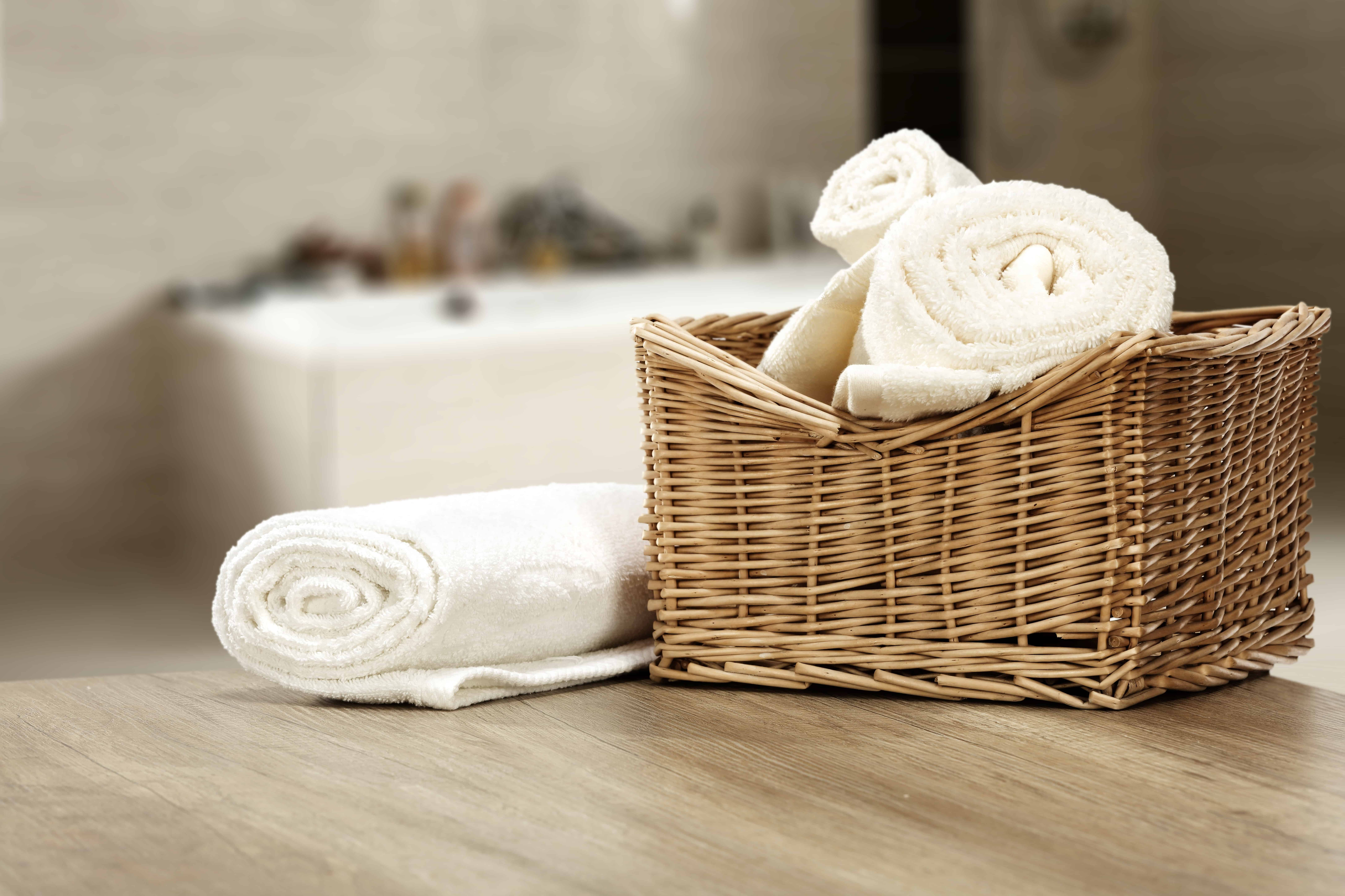 white towels in a wooden basket