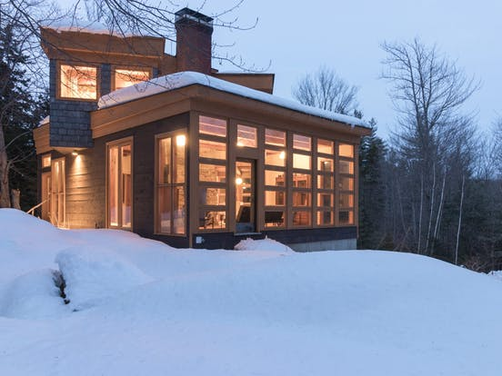 A cabin on a snowy evening in Ludlow, Vermont