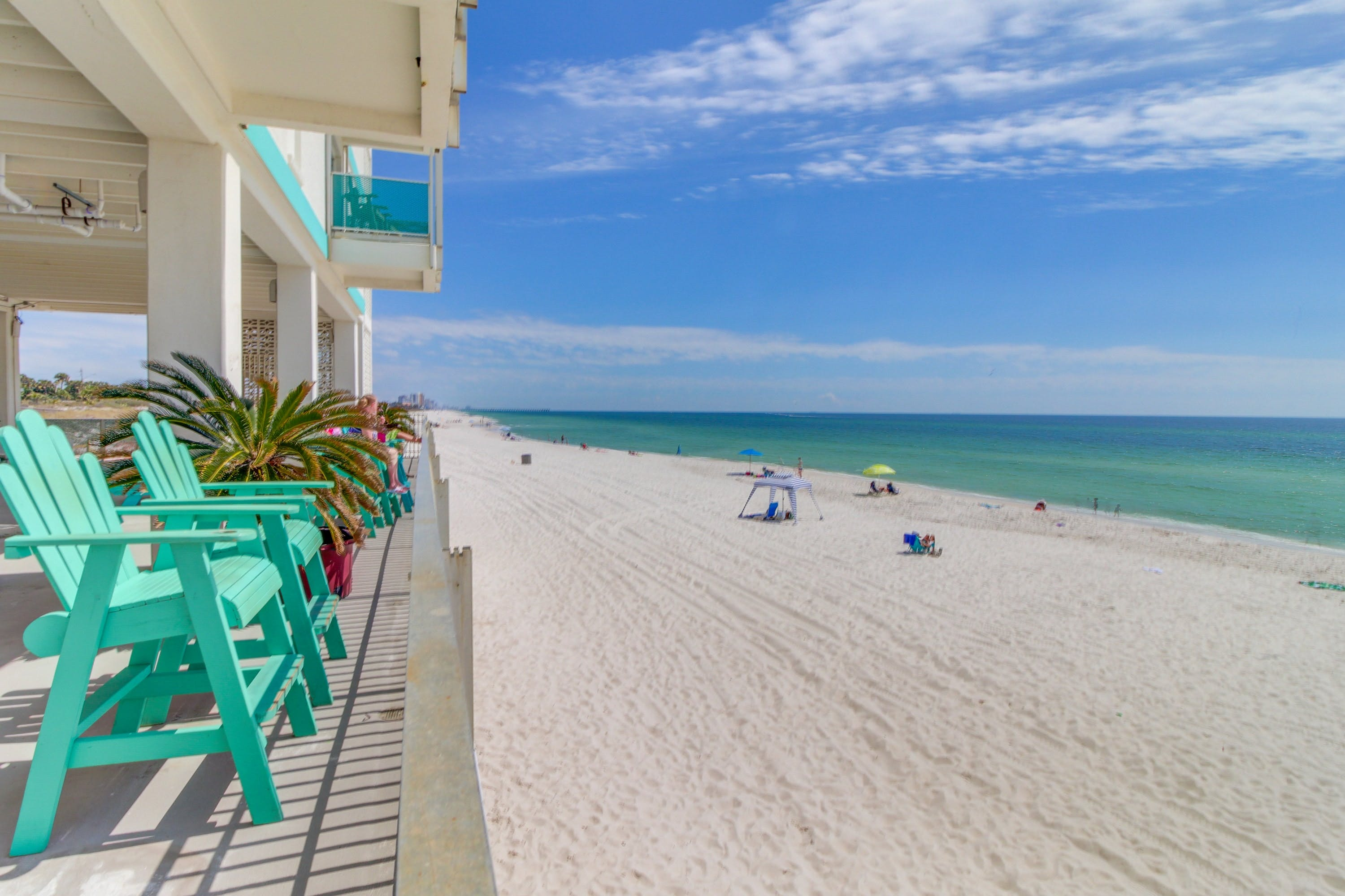 Turquoise chairs overlooking turquoise waters of Panama City Beach