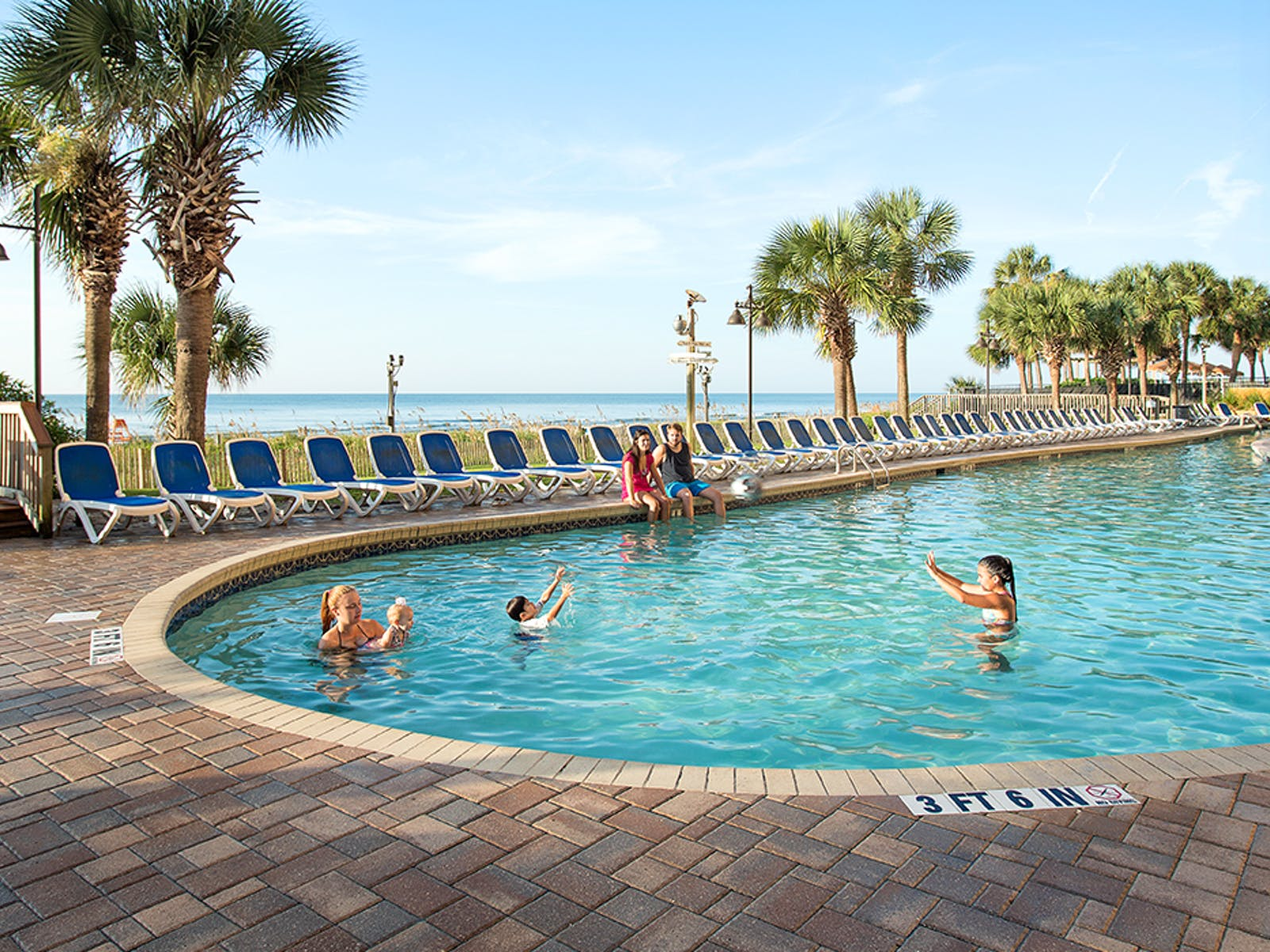 family plays in resort pool of Patricia Grand in Myrtle beach