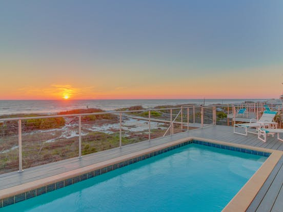 view of beach and outdoor pool of Port St. Joe, FL vacation rental