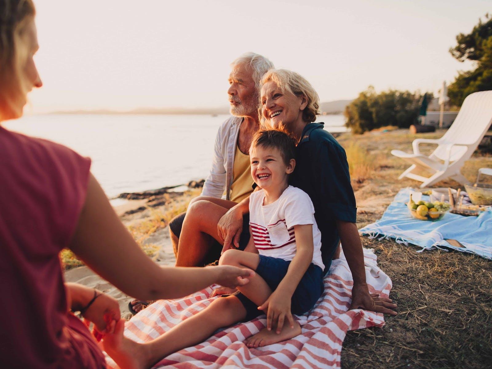 a family having a picnic at the lake