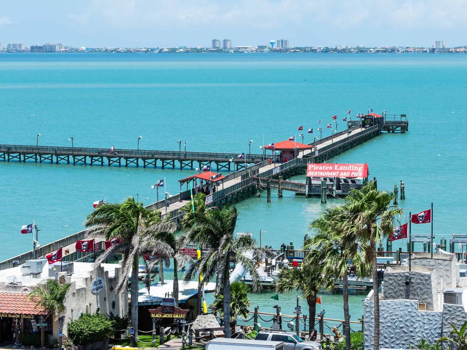 view of the pier and blue ocean in south padre island, texas