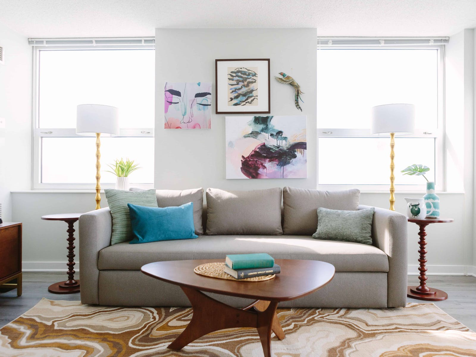 Living room of vacation rental with trendy artwork, area rug and decorative pillows