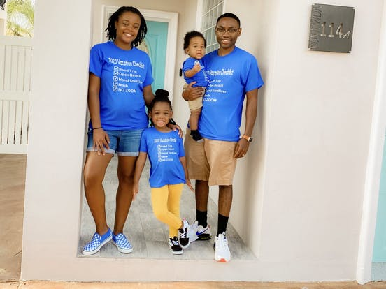 Victoria Graham and her family pose in front of their Vacasa vacation rental Texas