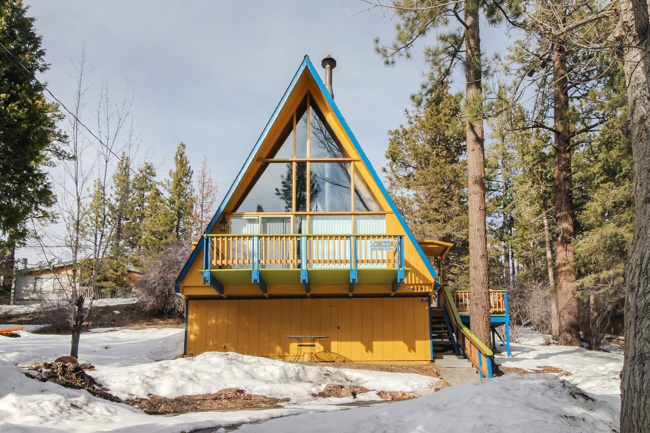 Cheery yellow and turquoise a-frame vacation cabin located in Big Bear, CA
