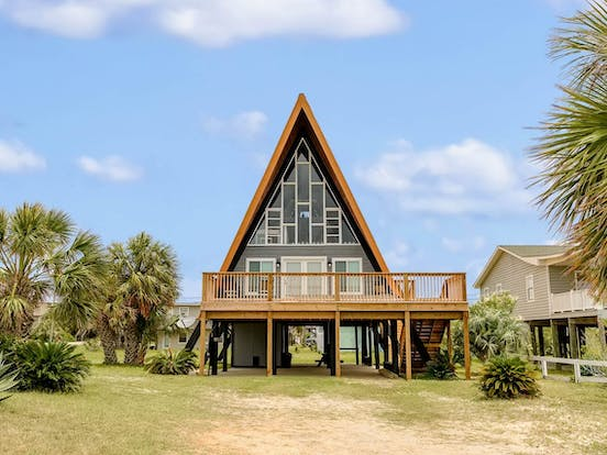 Dauphin Island, AL a-frame vacation rental surrounded by palm trees