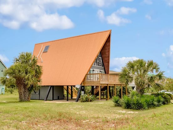 Exterior of a-frame vacation rental located on Dauphin Island