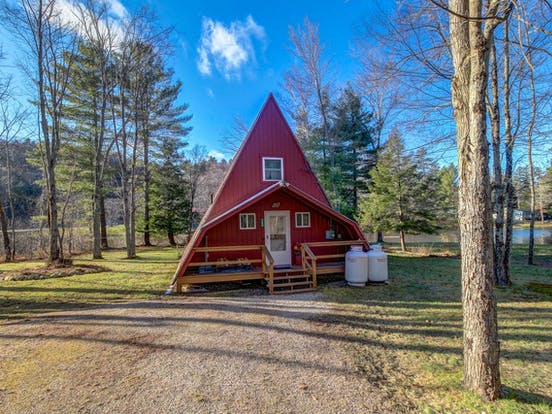 Bright red a-frame cabin rental located in Ludlow, VT