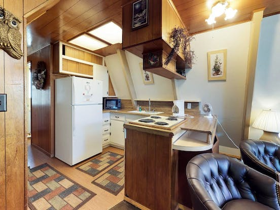 Kitchen area of a-frame rental located in Shaver Lake, CA