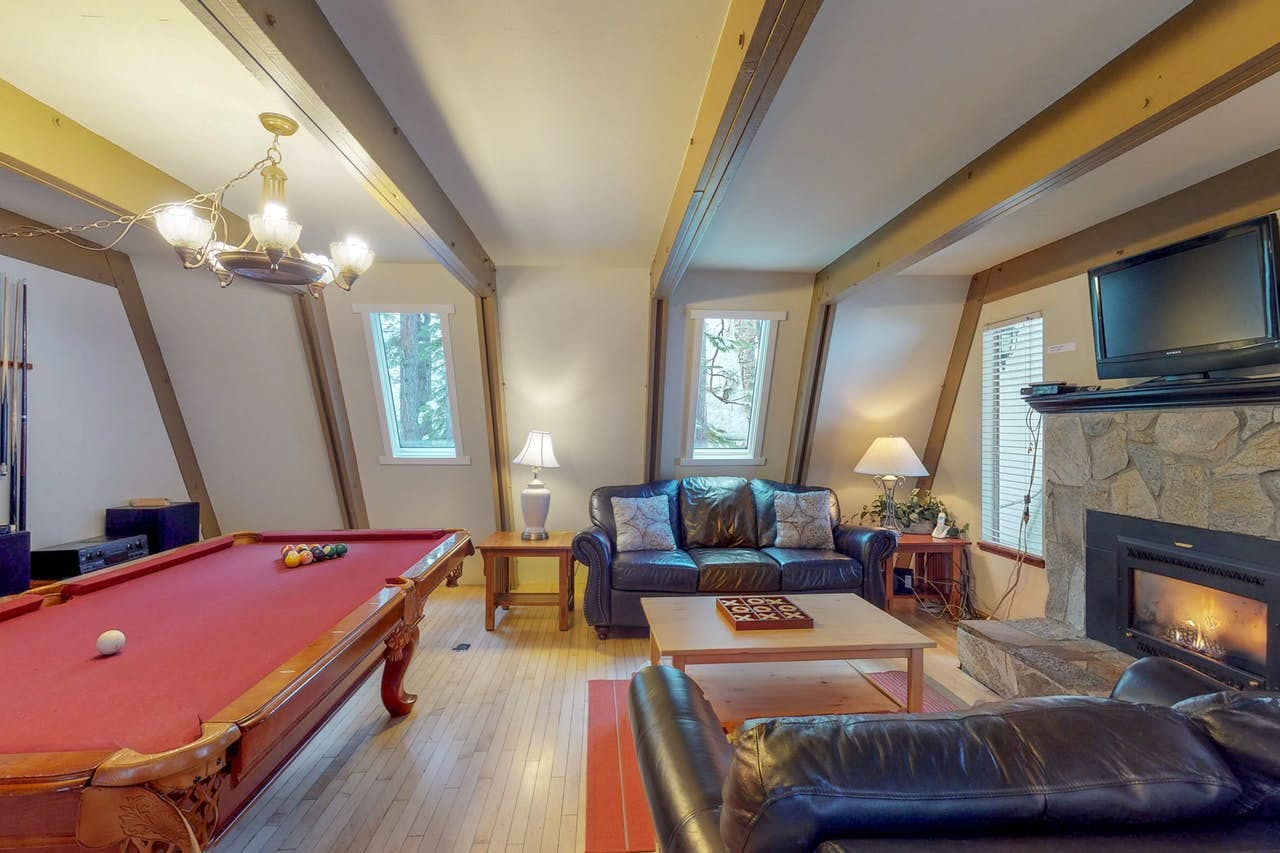 Pool table and fireplace inside this South Lake Tahoe a-frame cabin rental