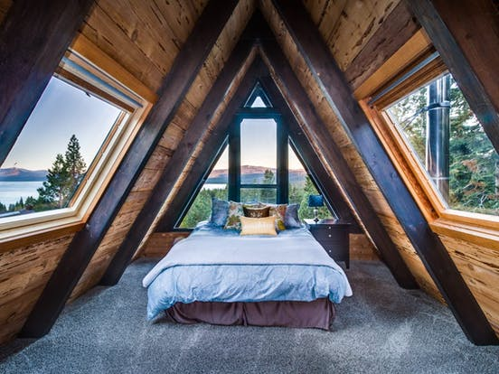 Gorgeous bedroom of a-frame vacation cabin located in Tahoe City, CA