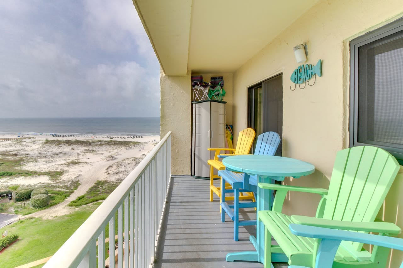 a colorful array of beach chairs on a deck overlooking the beach at Gulf Highlands