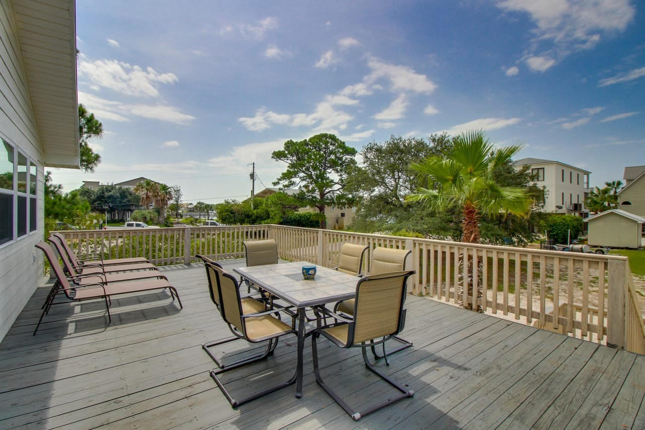 an outdoor dining area at a vacation home in Orange Beach, AL