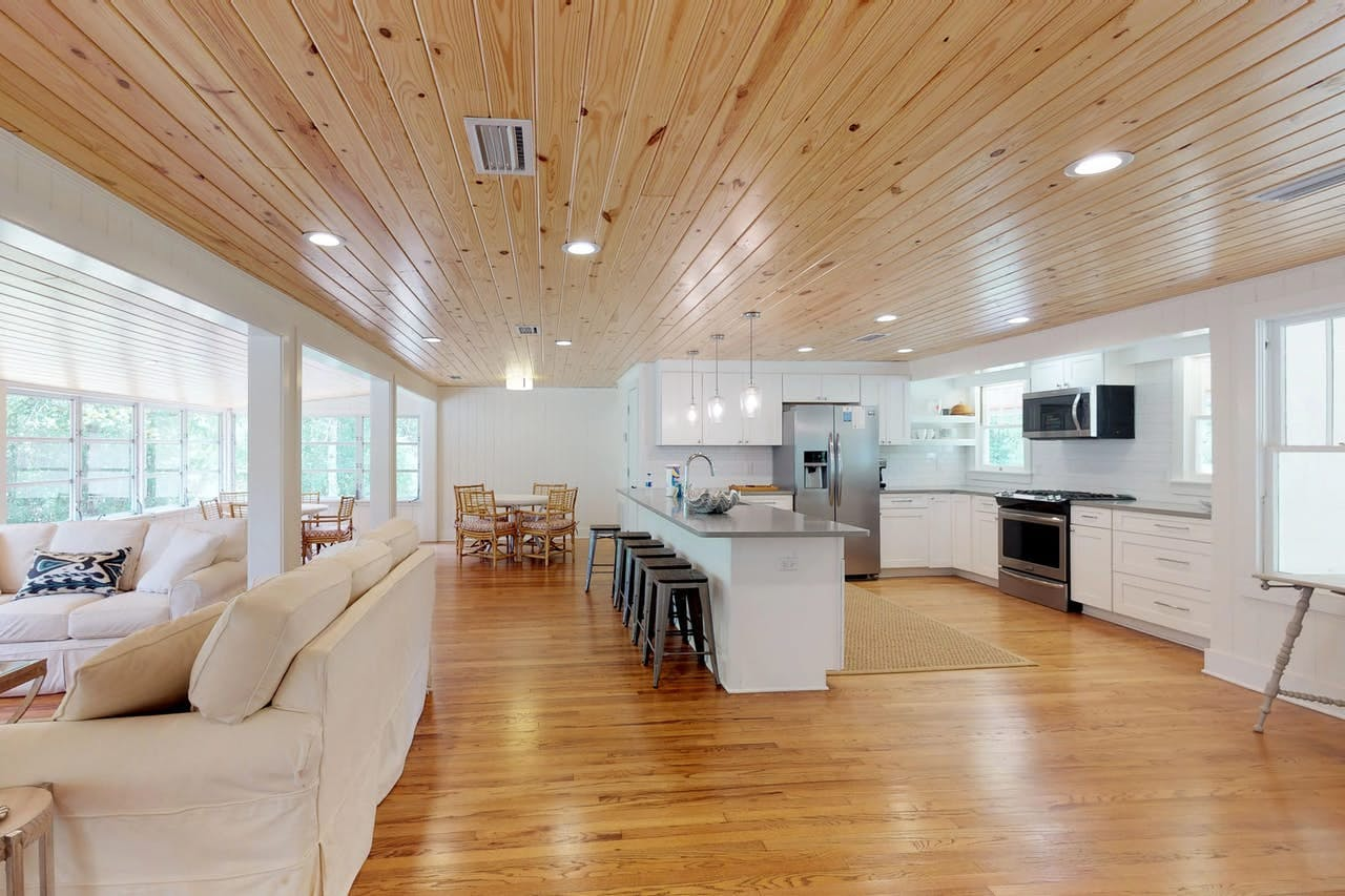 The kitchen and living room of a modern alabama vacation home