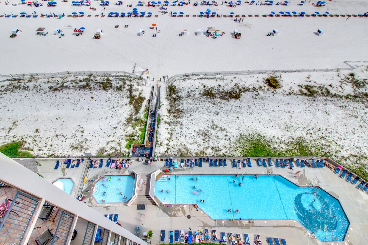 an arial view of the pool and beach from a condo building in Perdido Key