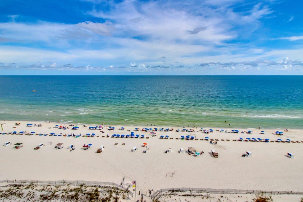 an arial view of beachgoers in the beach chairs in Orange Beach