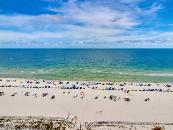 an arial view of beachgoers enjoying Orange Beach