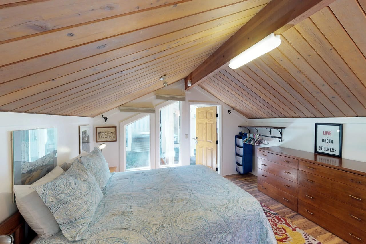 the upstairs bedroom in a girdwood cabin