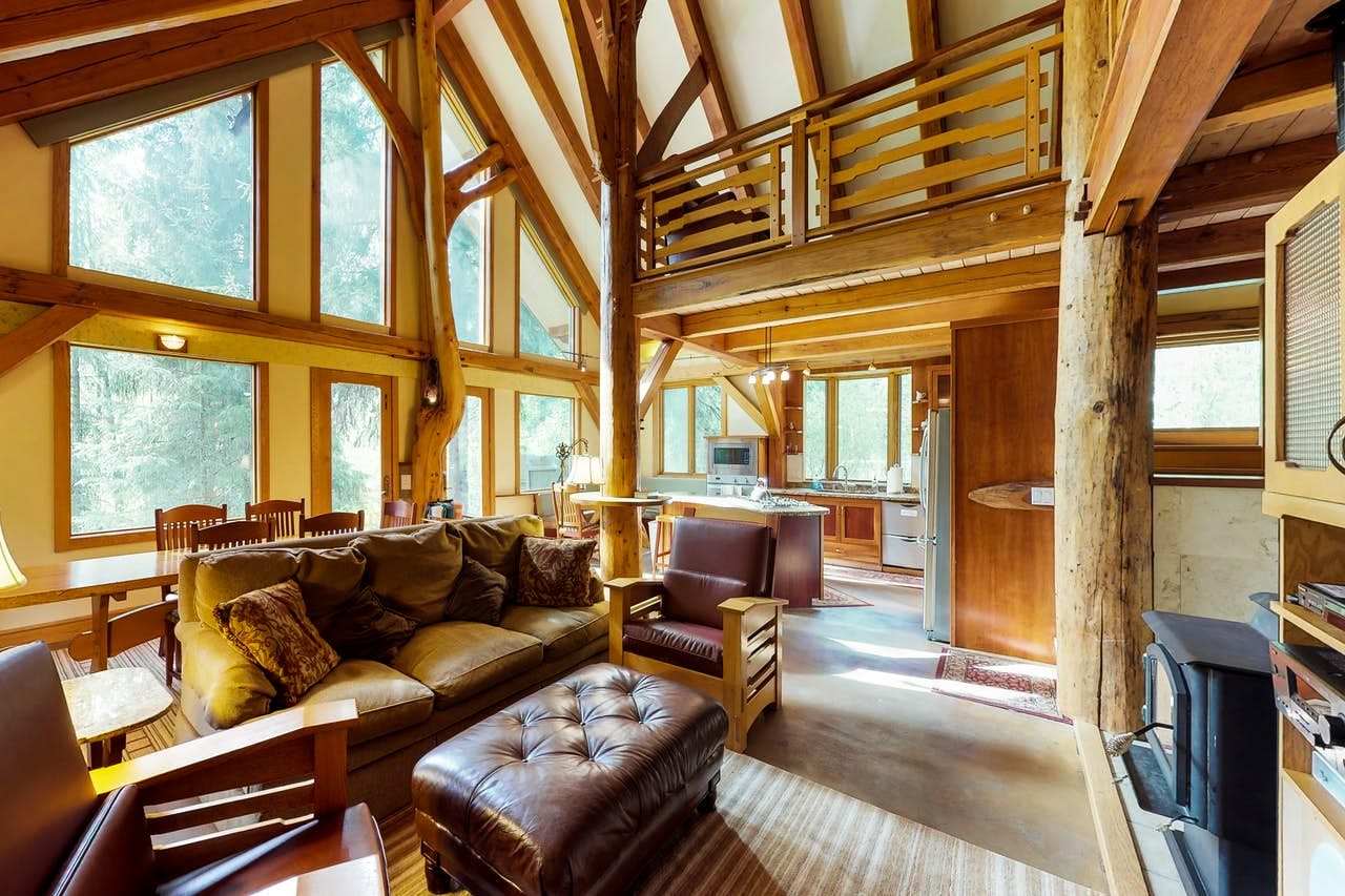 a unique living room with large tree trunks throughout the interior